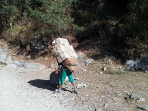 Local Sherpas carry extraordinary loads up the mountain trails seemingly with ease.