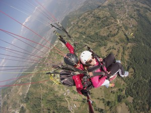 Natalie paraglides off Sarangkot with a guide going from thermal to thermal using hawks vultures and other paragliders to find where to get the best lift